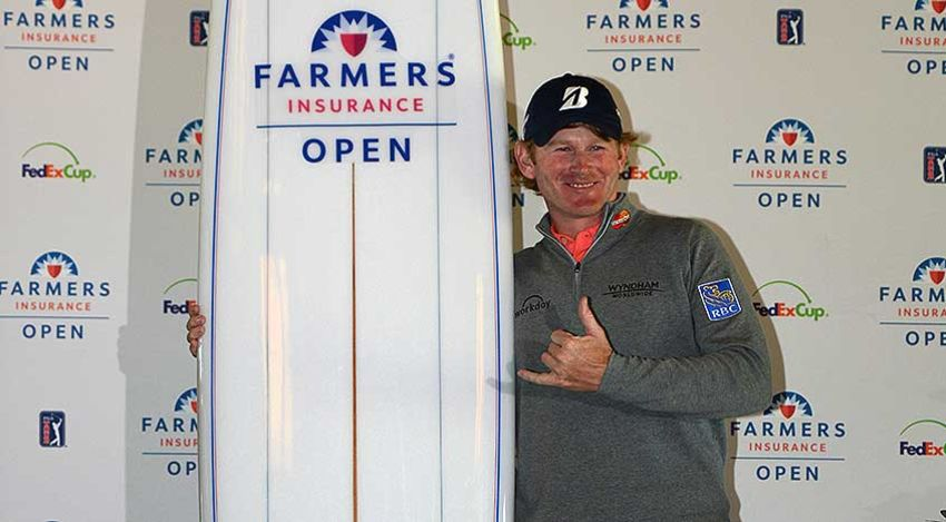 Brandt Snedeker with the totally inappropriate surfboard trophy at Farmers