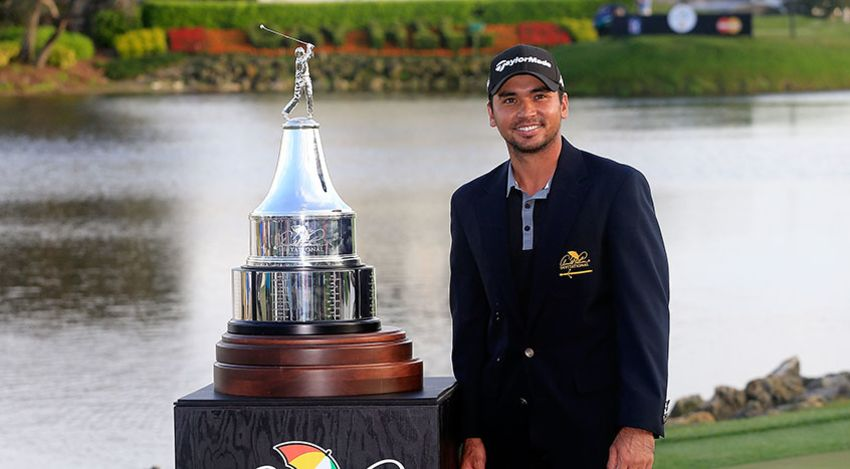 Jason Day with API trophy