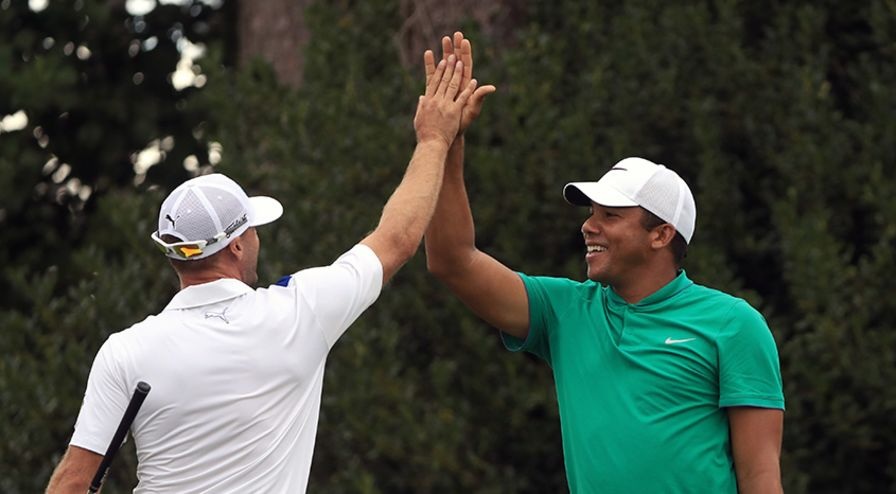 Jhonattan Vegas is congratulated by Graham DeLaet after his hole-in-one on the 17th hole. (Sam Greenwood/PGA TOUR)