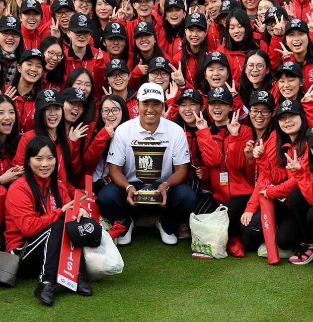 Hideki Matsuyama with WGC trophy and many fans